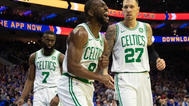 Boston Celtics guard Kemba Walker (8), guard Jaylen Brown (7) and center Daniel Theis (27)
