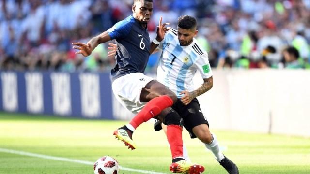 France midfielder Paul Pogba (6) and Argentina midfielder Ever Banega (7)