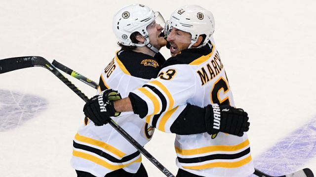 Boston Bruins defenseman Torey Krug and left wing Brad Marchand