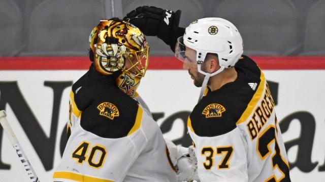 Boston Bruins' Tuukka Rask And Patrice Bergeron