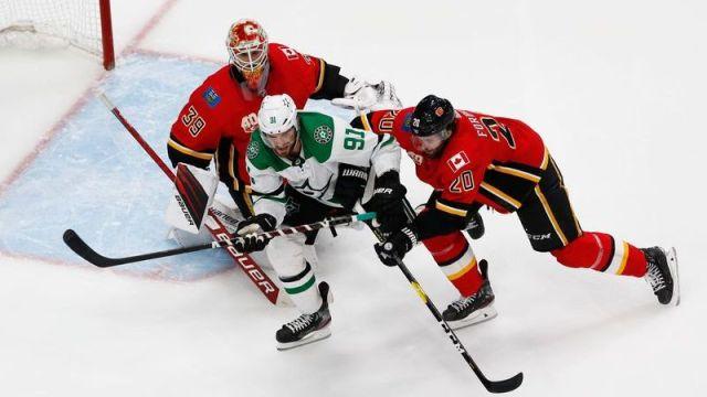Dallas Stars center Tyler Seguin, Calgary Flames goaltender Cam Talbot, Calgary Flames defenseman Derek Forbort