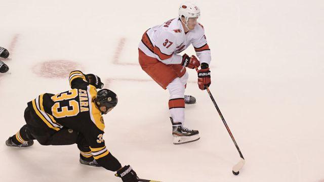 Boston Bruins defenseman Zdeno Chara and Carolina Hurricanes right wing Andrei Svechnikov