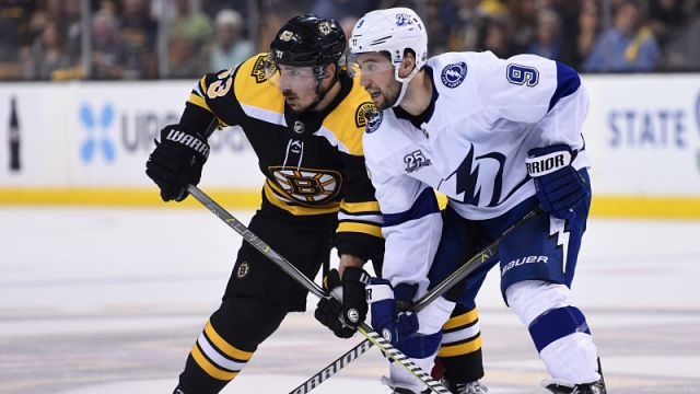 Boston Bruins forward Brad Marchand and Tampa Bay Lightning forward Tyler Johnson