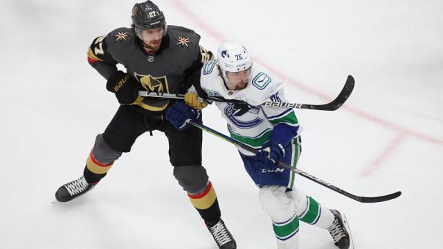 egas Golden Knights defenseman Shea Theodore and Vancouver Canucks left wing Antoine Roussel