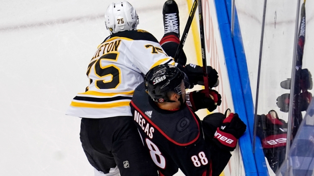 Boston Bruins defenseman Connor Clifton, Carolina Hurricanes winger Matin Necas