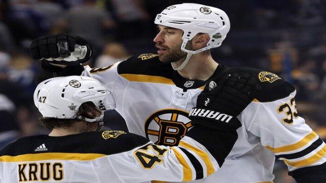Boston Bruins' Torey Krug And Zdeno Chara