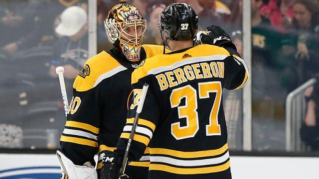 Boston Bruins players Tuukka Rask and Patrice Bergeron