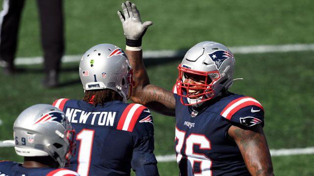 New England Patriots quarterback Cam Newton and left tackle Isaiah Wynn