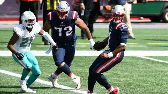 Miami Dolphins cornerback Eric Rowe and New England Patriots quarterback Cam Newton