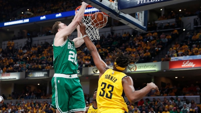 Boston Celtics forward Gordon Hayward (left) and Indiana Pacers center Myles Turner
