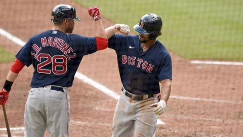 Boston Red Sox designated hitter J.D. Martinez, Boston Red Sox shortstop Xander Bogaerts