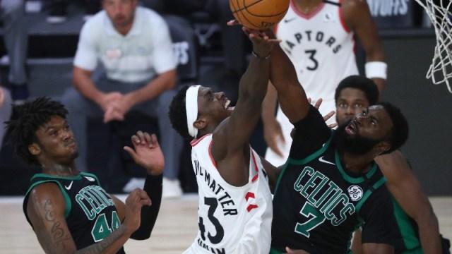 Toronto Raptors forward Pascal Siakam (43) and Boston center Robert Williams III (44) and Celtics guard Jaylen Brown (7)
