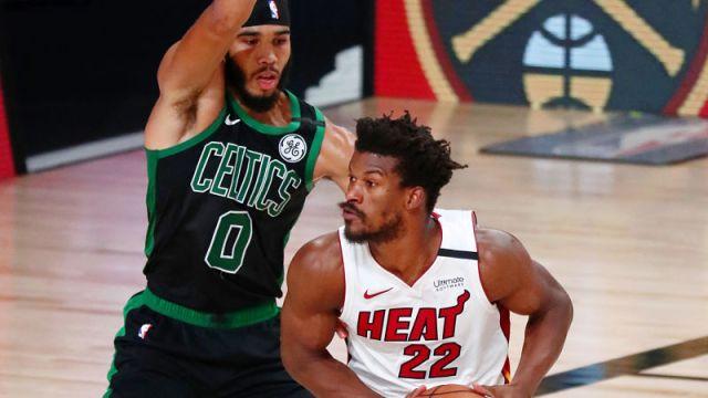 Boston Celtics forward Jayson Tatum and Miami Heat forward Jimmy Butler