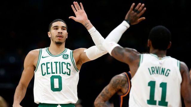 Boston Celtics forward Jayson Tatum, Former Boston Celtics point guard Kyrie Irving