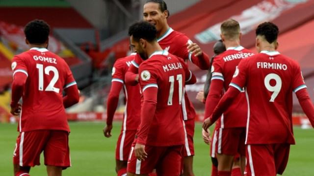Liverpool forward Mohamed Salah (11), defender Virgil van Dijk (4) and teammates