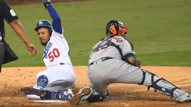 Los Angeles Dodgers right fielder Mookie Betts (50) and Houston Astros catcher Martin Maldonado (15)
