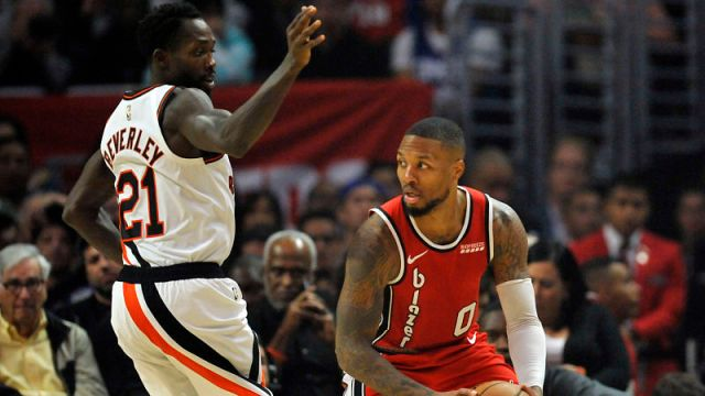 Los Angeles Clippers guard Patrick Beverley and Portland Trail Blazers guard Damian Lillard