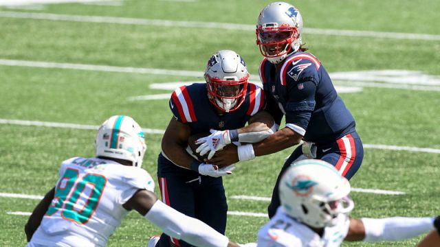 Miami Dolphins defensive end Shaq Lawson and New England Patriots quarterback Cam Newton