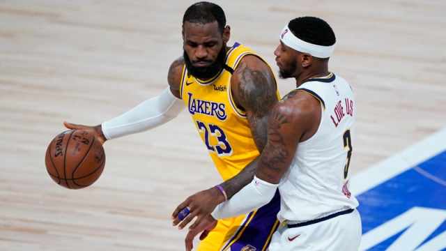 Los Angeles Lakers forward LeBron James, Denver Nuggets forward Torrey Craig