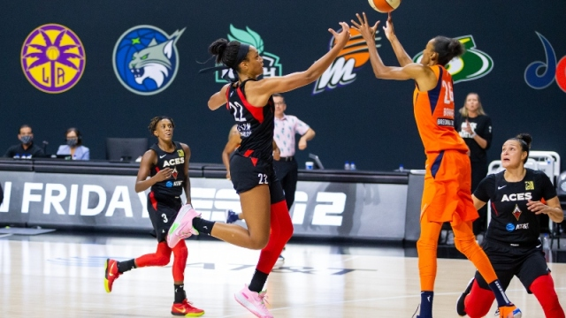 Las Vegas Aces center A'ja Wilson (22) and Connecticut Sun forward DeWanna Bonner (24)