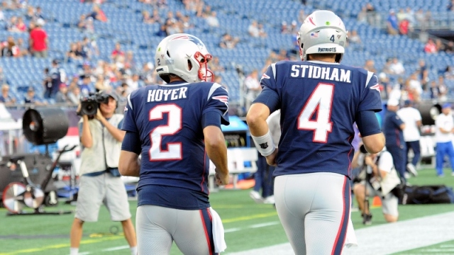 New England Patriots quarterbacks Brian Hoyer (2) and quarterback Jarret Stidham (4)