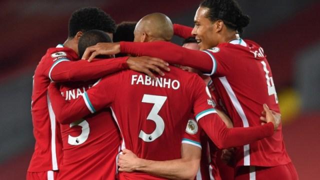 Liverpool midfielder Fabinho (center), defender Virgil van Dijk (right) and teammates