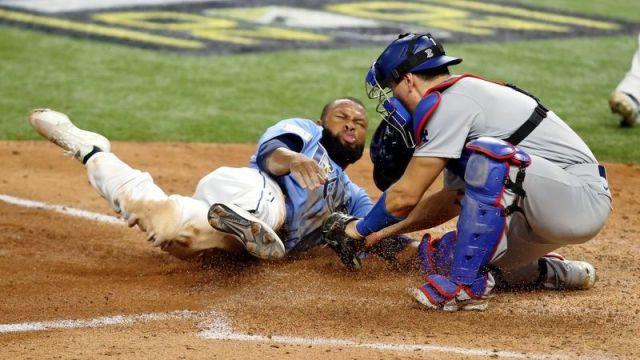 Los Angeles Dodgers catcher Austin Barnes, Tampa Bay Rays left fielder Manuel Margot