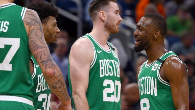 Boston Celtics guard Kemba Walker (8), guard Marcus Smart (36) and forward Gordon Hayward (20)