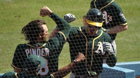 Oakland Athletics third basemen Chad Pinder, Oakland Athletics left fielder Mark Canha