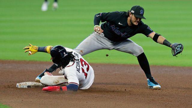 Atlanta Braves center fielder Ronald Acuna Jr. and Miami Marlins shortstop Miguel Rojas