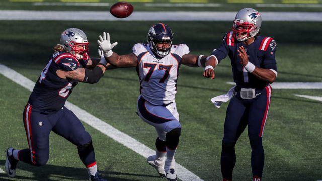 Denver Broncos defensive end Timmy Jernigan and New England Patriots quarterback Cam Newton
