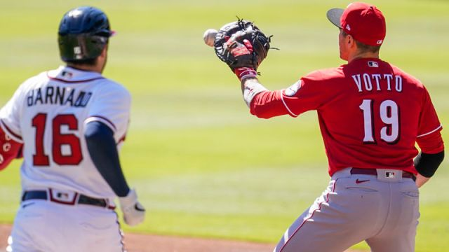Atlanta Braves catcher Travis d'Arnaud and Cincinnati Reds first baseman Joey Votto