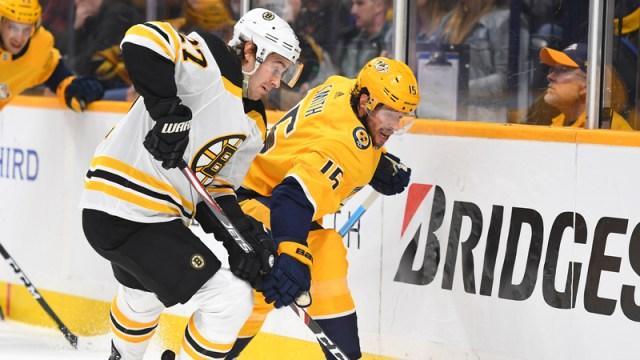 Boston Bruins defenseman John Moore, Nashville Predators forward Craig Smith