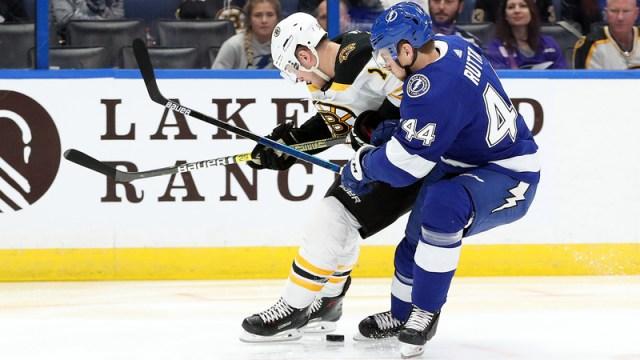 Tampa Bay Lightning defenseman Jan Rutta, Boston Bruins winger Chris Wagner