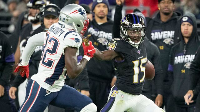 New England Patriots safety Devin McCourty and Baltimore Ravens wide receiver Marquise Brown