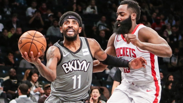 Brooklyn Nets guard Kyrie Irving (11) and Houston Rockets guard James Harden (13)
