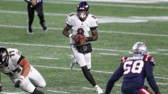 Baltimore Ravens quarterback Lamar Jackson and New England Patriots linebacker Anfernee Jennings