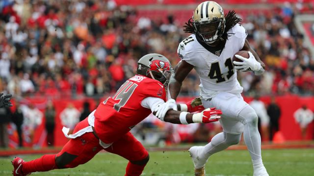 Tampa Bay Buccaneers safety Mike Edwards and New Orleans Saints running back Alvin Kamara