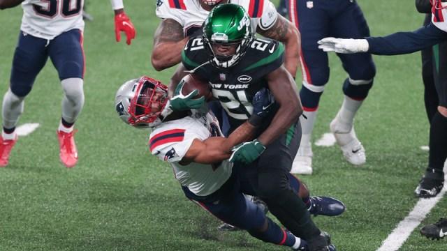 New York Jets' Frank Gore, New England Patriots' Adrian Phillips