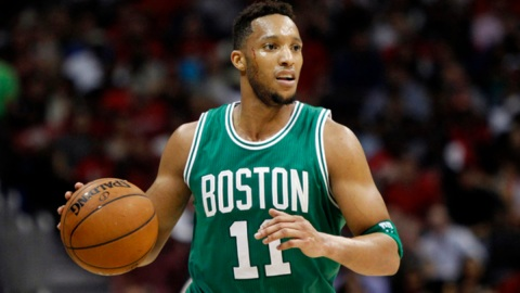 Boston Celtics guard Evan Turner (11) dribbles against the Atlanta Hawks in the third quarter in game five of the first round of the NBA Playoffs at Philips Arena.