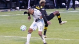 Columbus Crew SC forward Gyasi Zardes (right) and New England Revolution defender Andrew Farrell (2)