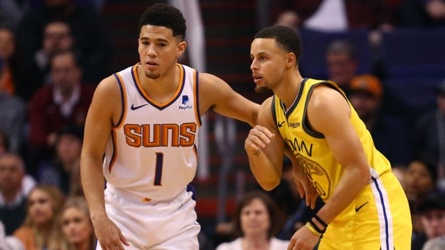 Phoenix Suns guard Devin Booker and Golden State Warriors guard Stephen Curry