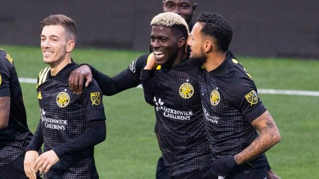 Columbus Crew SC forward Gyasi Zardes (center) and teammates