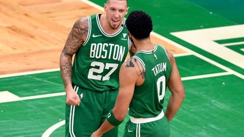 Boston Celtics forward Jayson Tatum (0) and center Daniel Theis (27)