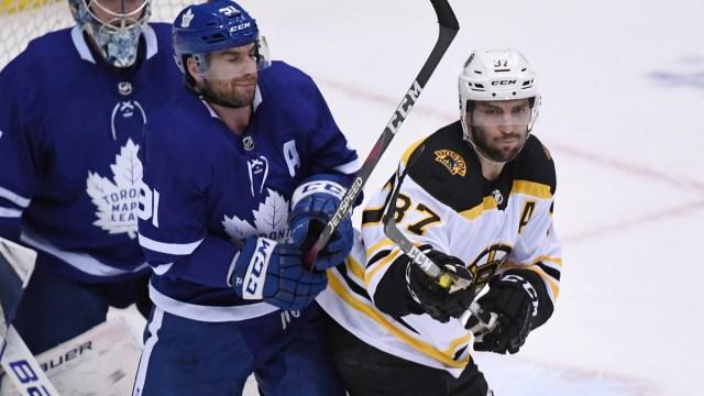 Boston Bruins center Patrice Bergeron, Toronto Maple Leafs center John Tavares
