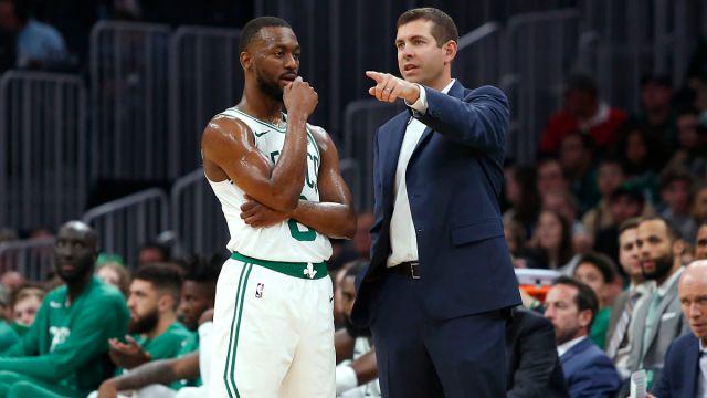 Boston Celtics guard Kemba Walker, head coach Brad Stevens
