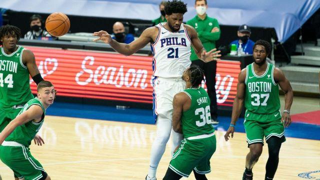 Boston Celtics guard Marcus Smart, Philadelphia 76ers center Joel Embiid