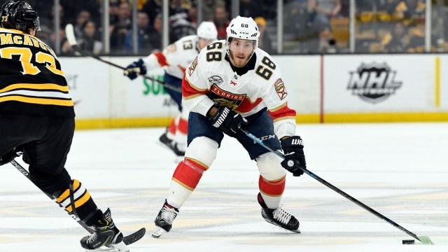 Free agent winger Mike Hoffman, Boston Bruins defenseman Charlie McAvoy