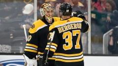 Boston Bruins goaltender Tuukka Rask (40) and center Patrice Bergeron (37)
