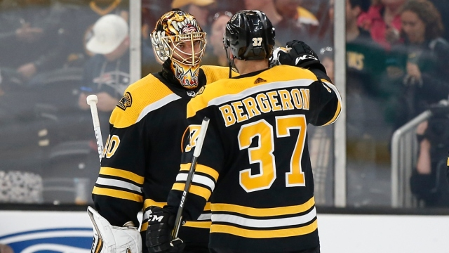Boston Bruins goaltender Tuukka Rask (40) and center Patrice Bergeron (37)